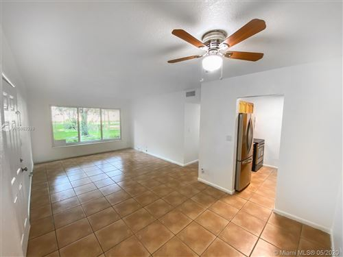 Photo of 2600 NW 39th Way #102, Lauderdale Lakes, FL 33311 (MLS # A10862339)