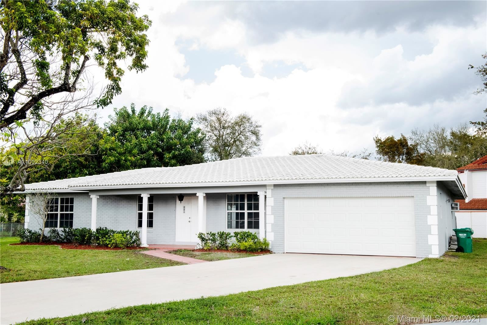 Photo of 9011 NW 23rd St, Coral Springs, FL 33065 (MLS # A11002340)