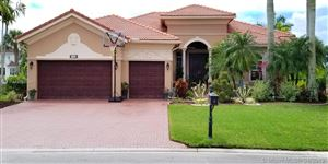 Photo of 7423 NW 124th Ave, Parkland, FL 33076 (MLS # A10661341)