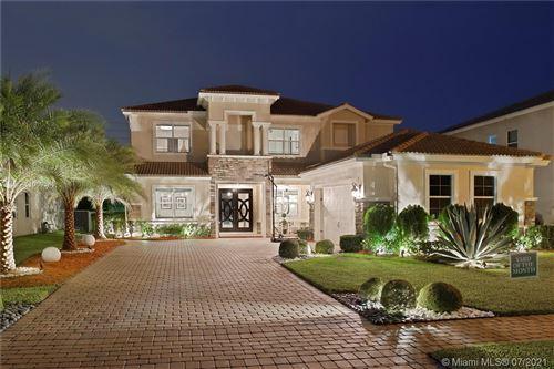 Photo of 8952 Cypress Grove Ln, Royal Palm Beach, FL 33411 (MLS # A11069341)