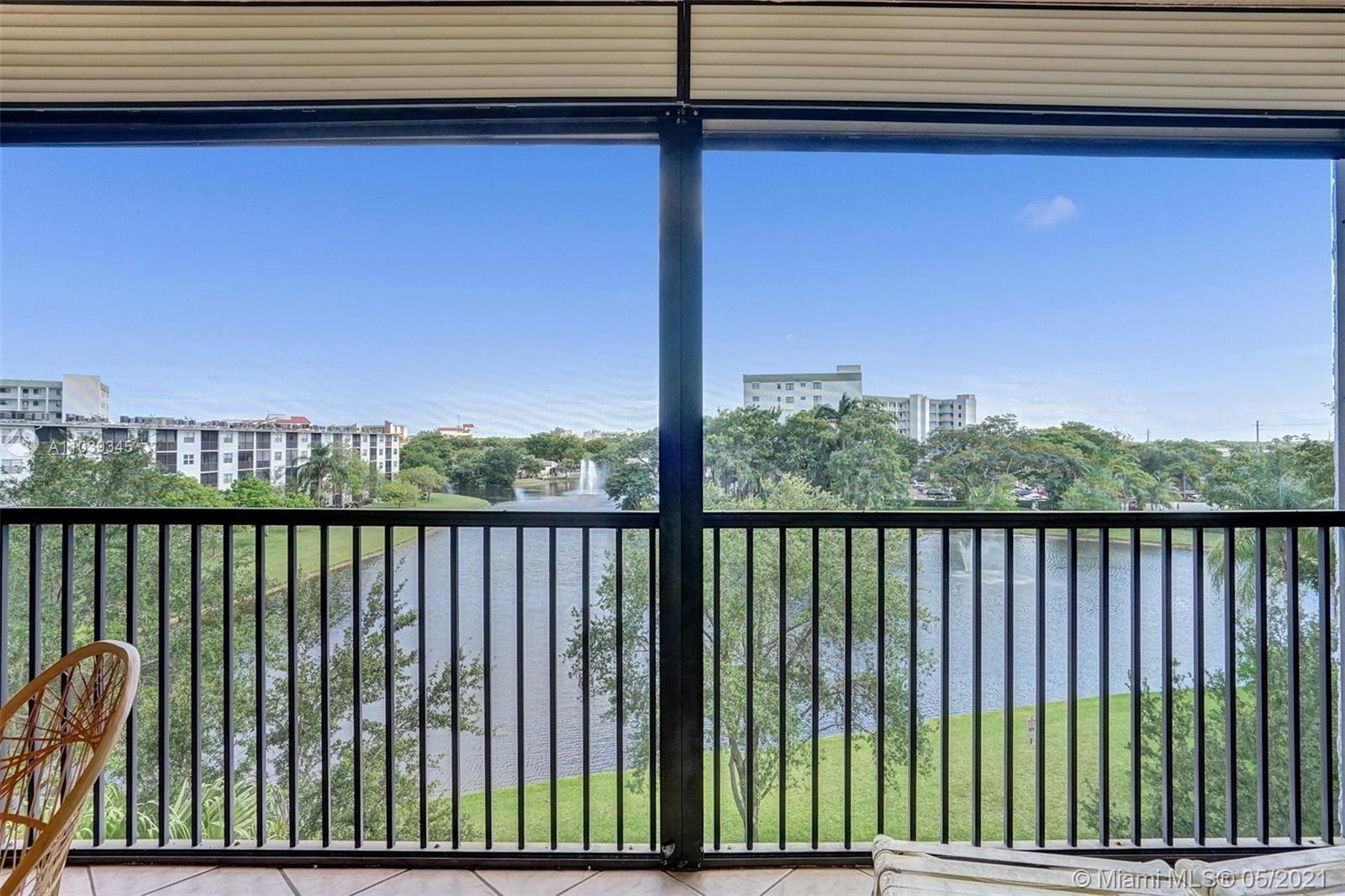 Photo of 2238 N Cypress Bend Dr #507, Pompano Beach, FL 33069 (MLS # A11039345)