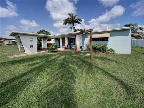 Photo of 7561 Eaton St, Hollywood, FL 33024 (MLS # A11111346)