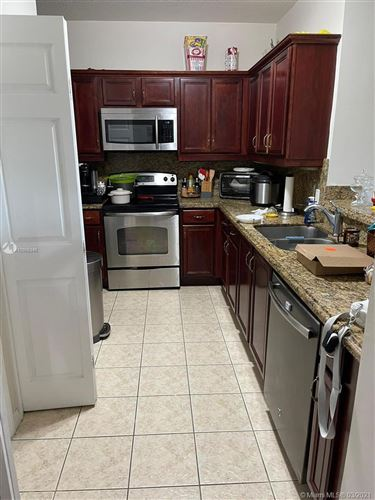 Photo of 5271 SW 8th St #502, Miami, FL 33134 (MLS # A10955348)