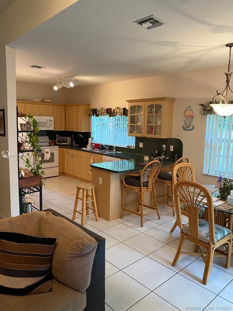 Photo of 12297 Natalies Cove Rd, Cooper City, FL 33330 (MLS # A10950350)