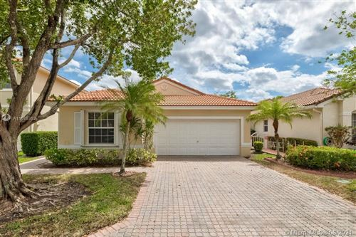 Photo of 11034 NW 46th Drive, Coral Springs, FL 33076 (MLS # A11025352)