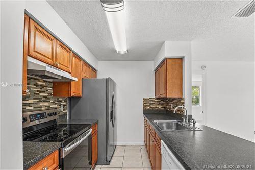 Photo of 10461 NW 7th St #204, Pembroke Pines, FL 33026 (MLS # A11097352)