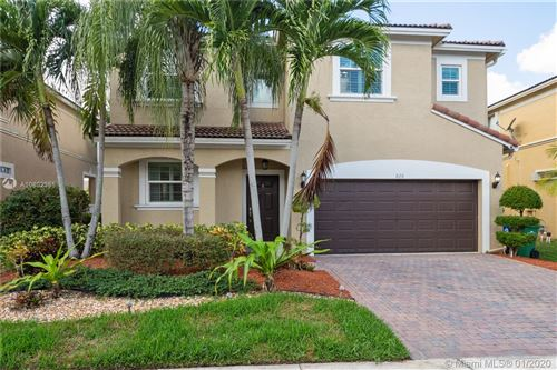 Photo of Listing MLS a10802355 in 826 NW 127th Ave Coral Springs FL 33071