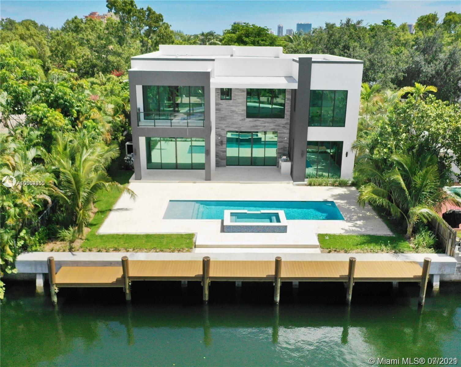 Photo of 13040 Ortega Ln, North Miami, FL 33181 (MLS # A10962355)