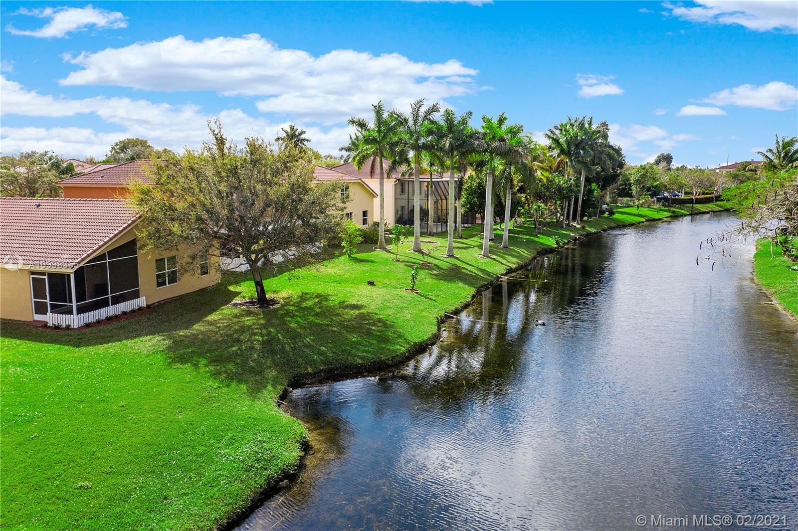 Photo of 380 NW 115th Way, Coral Springs, FL 33071 (MLS # A10998355)
