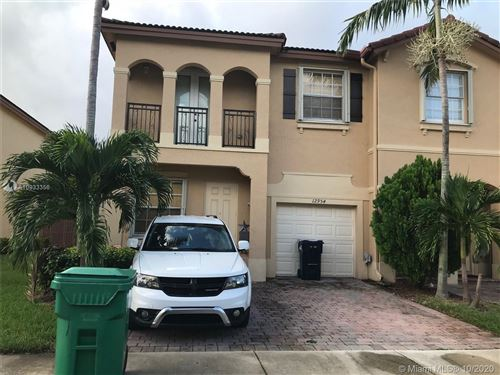 Photo of 12954 SW 133rd Ter #12954, Miami, FL 33186 (MLS # A10933356)