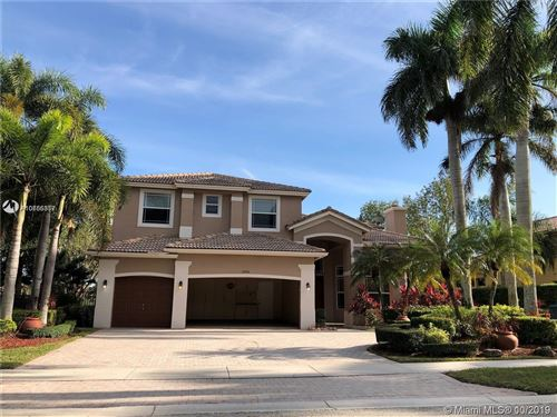 Photo of 2541 Montclaire Cir, Weston, FL 33327 (MLS # A10755357)
