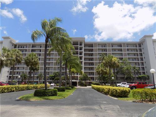 Photo of 3200 N Palm Aire Dr #405, Pompano Beach, FL 33069 (MLS # A10884357)
