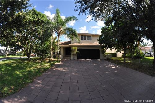 Photo of 4520 NW 52nd St, Coconut Creek, FL 33073 (MLS # A11014357)