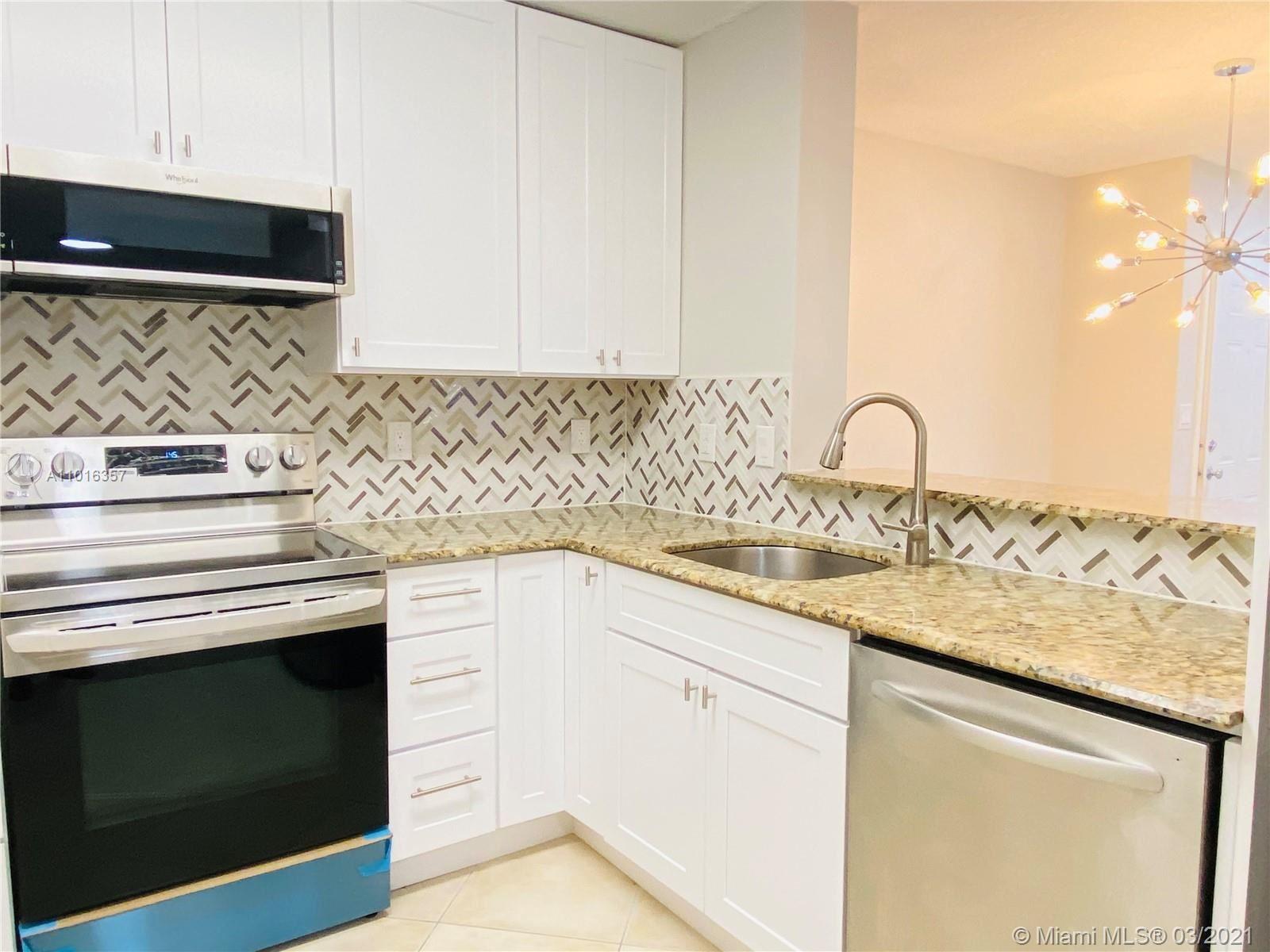 Photo of 509 E Sheridan St #103, Dania Beach, FL 33004 (MLS # A11016357)