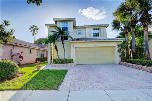 Photo of 1258 NW 170th Ave, Pembroke Pines, FL 33028 (MLS # A11030359)