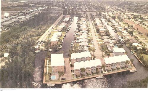 Photo of 4400 SW 42nd Ter, Dania Beach, FL 33314 (MLS # A11111361)