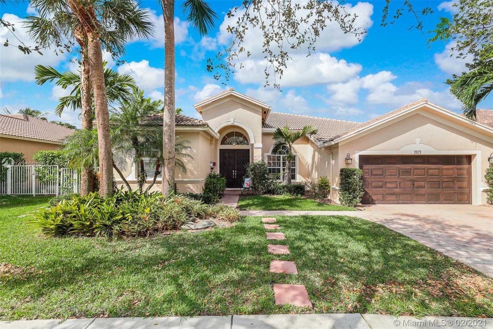Photo of 3921 W Gardenia Ave, Weston, FL 33332 (MLS # A11001362)