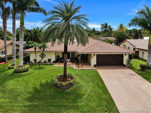 Photo of 11608 Fir St, Palm Beach Gardens, FL 33410 (MLS # A10873364)