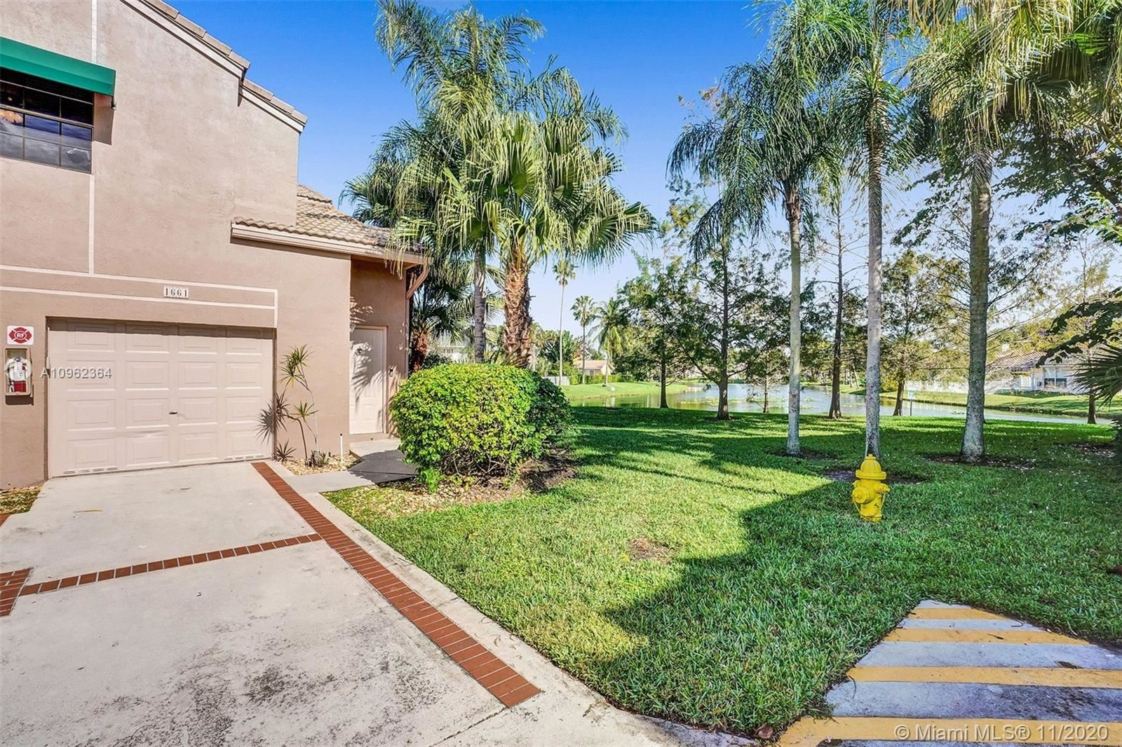 Photo of 1661 Cypress Pointe Dr #1661, Coral Springs, FL 33071 (MLS # A10962364)