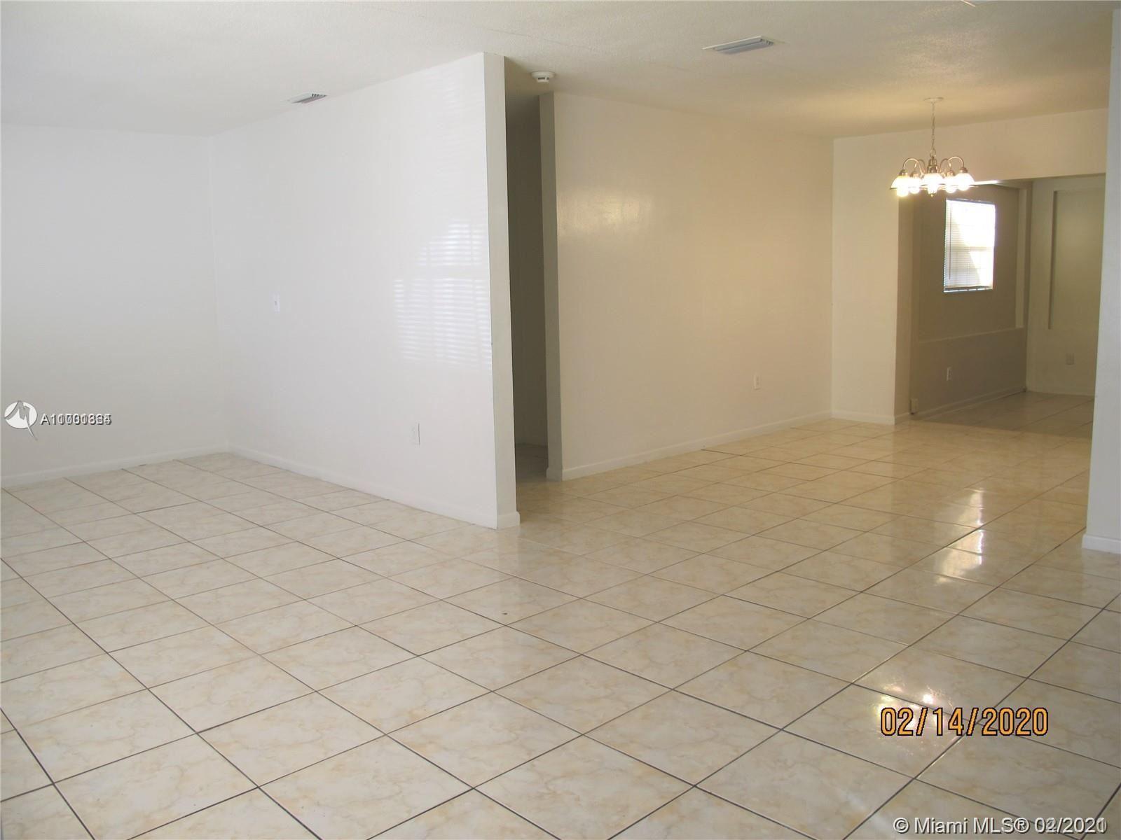 Photo of 5987 NW 16th St, Sunrise, FL 33313 (MLS # A11001364)