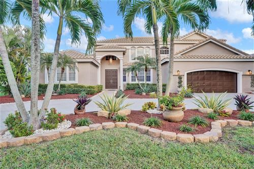 Photo of 1711 NW 127th Way, Coral Springs, FL 33071 (MLS # A10775365)