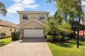Photo of 16560 SW 1st St, Pembroke Pines, FL 33027 (MLS # A11103365)
