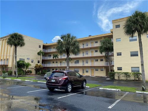 Photo of 3940 NW 42nd Ave #320, Lauderdale Lakes, FL 33319 (MLS # A11110368)