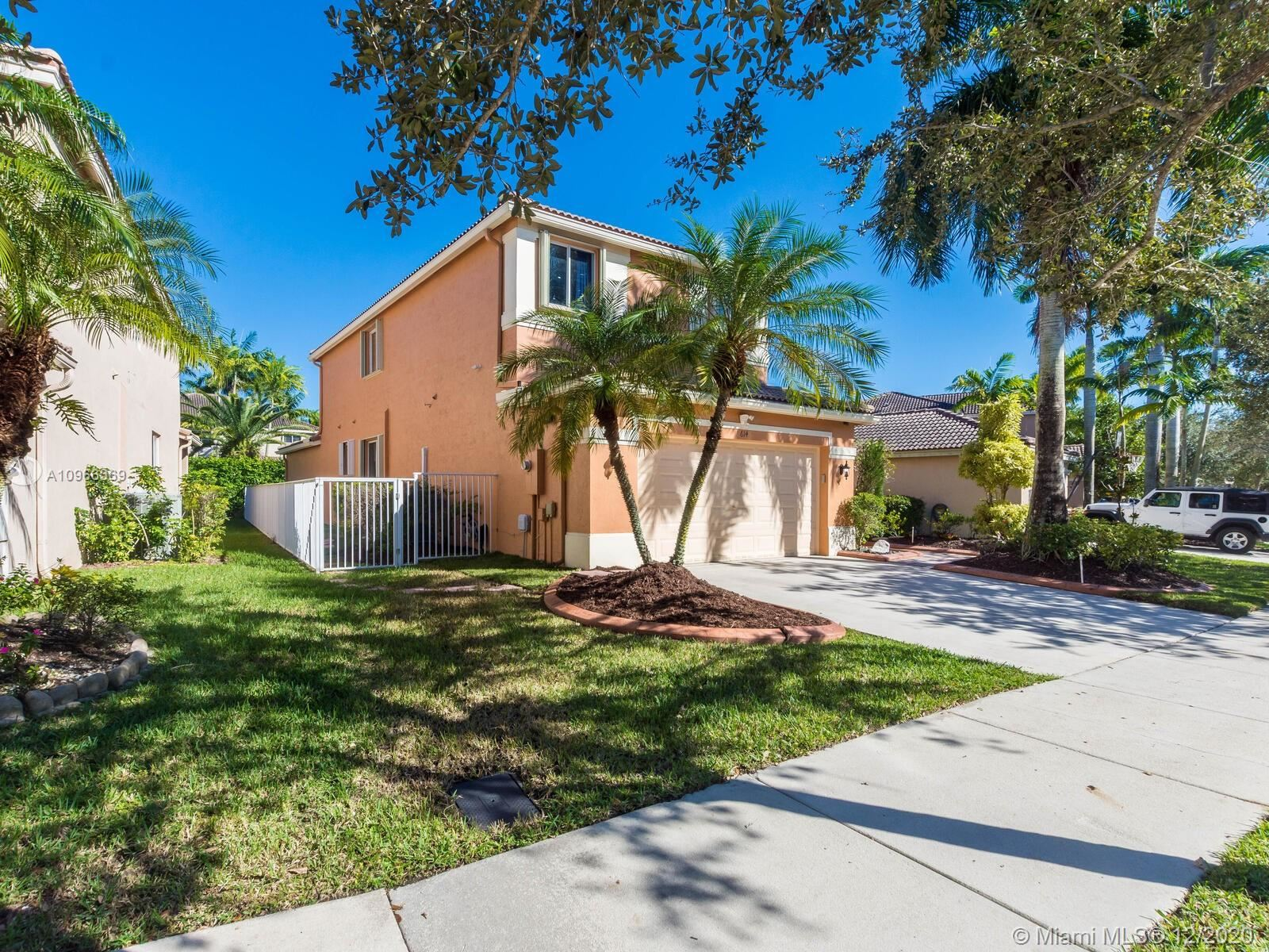 Photo of 614 Conservation Dr, Weston, FL 33327 (MLS # A10966369)