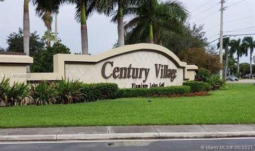 Photo of 1001 SW 128th Ter #213B, Pembroke Pines, FL 33027 (MLS # A11060370)