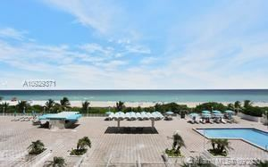 Photo of 5701 E collins ave #406, Miami Beach, FL 33140 (MLS # A10929371)