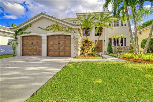 Photo of 813 Crestview Cir, Weston, FL 33327 (MLS # A10977371)