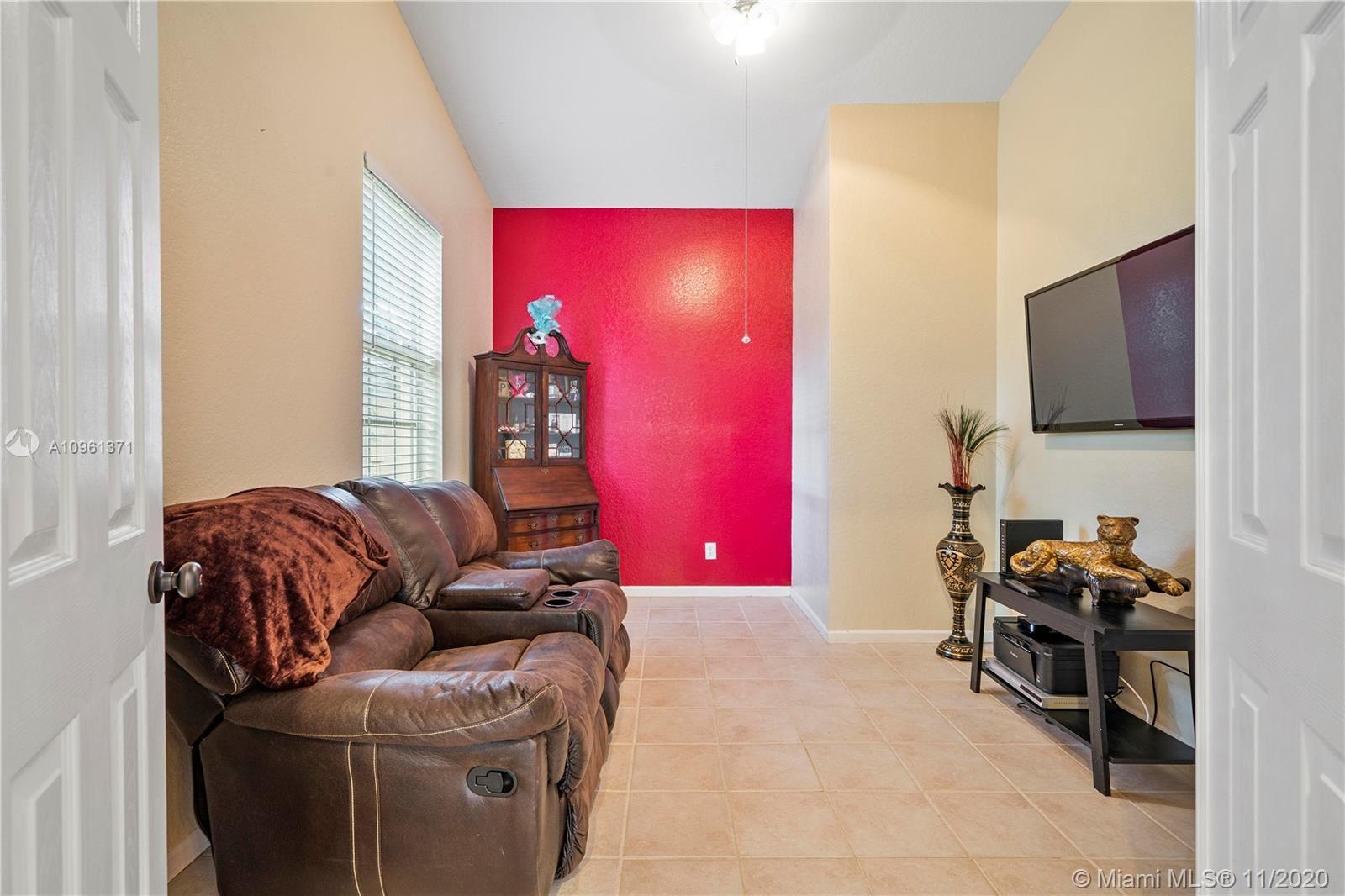 Photo of 5612 Enclave Lane, Lauderhill, FL 33319 (MLS # A10961371)