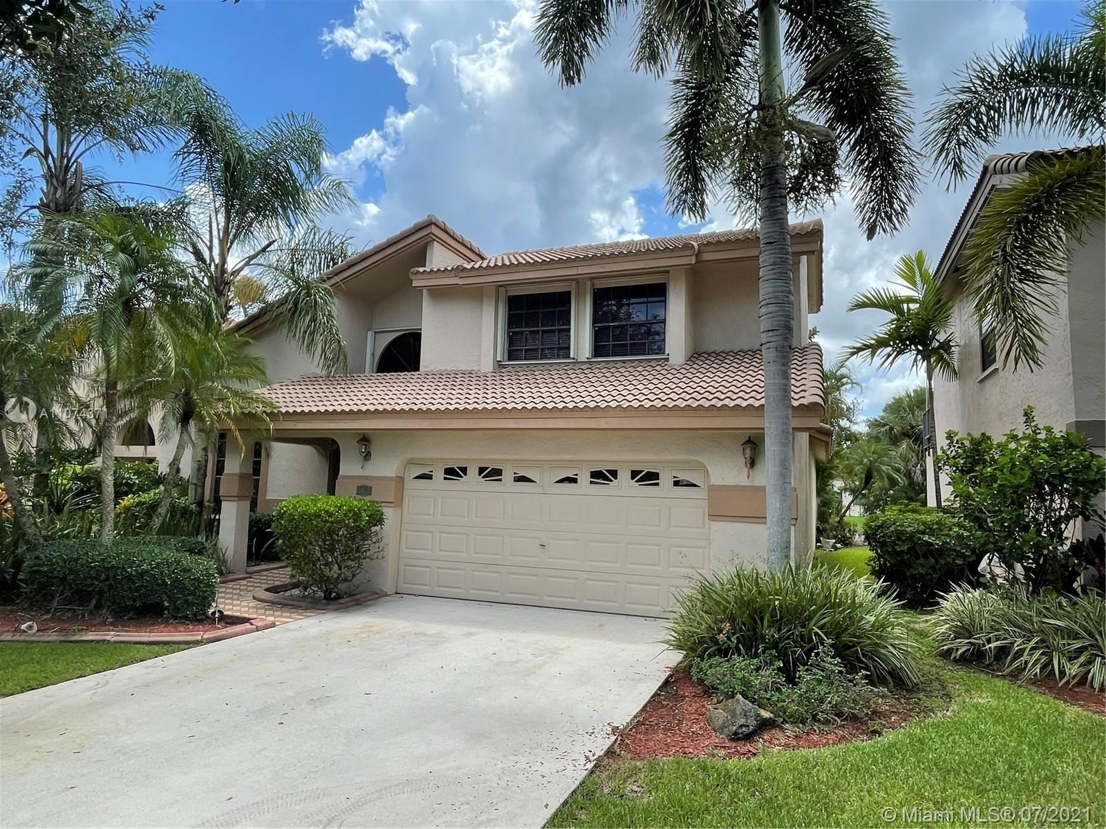 Photo of 1671 NW 103rd Ave, Plantation, FL 33322 (MLS # A11074371)