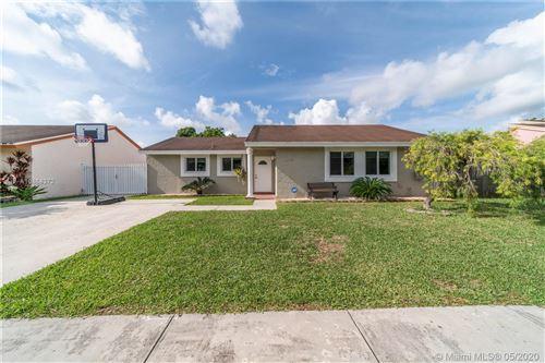 Photo of 12240 SW 207th Ter, Miami, FL 33177 (MLS # A10864372)