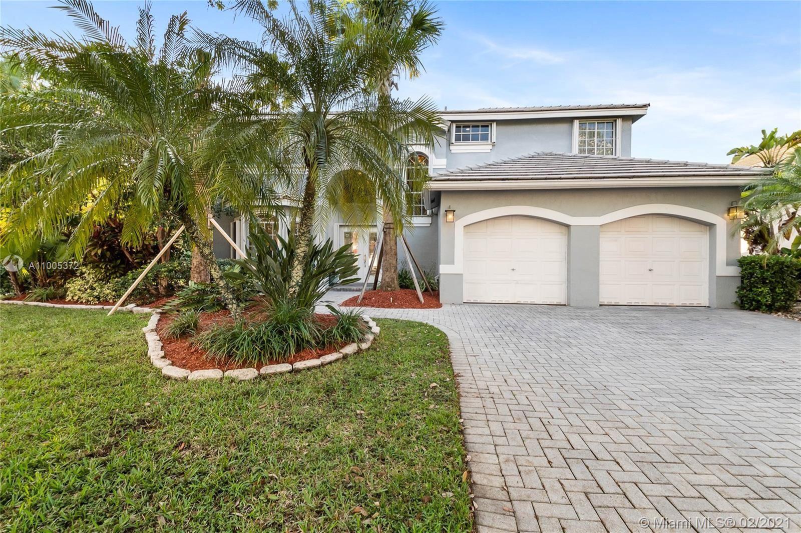 Photo of 2641 Oakbrook Ln, Weston, FL 33332 (MLS # A11005372)