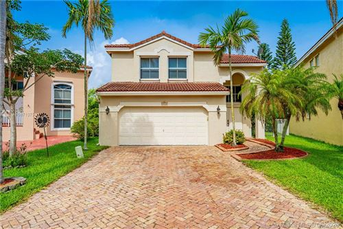 Photo of 3412 NW 110th Way, Coral Springs, FL 33065 (MLS # A10871375)
