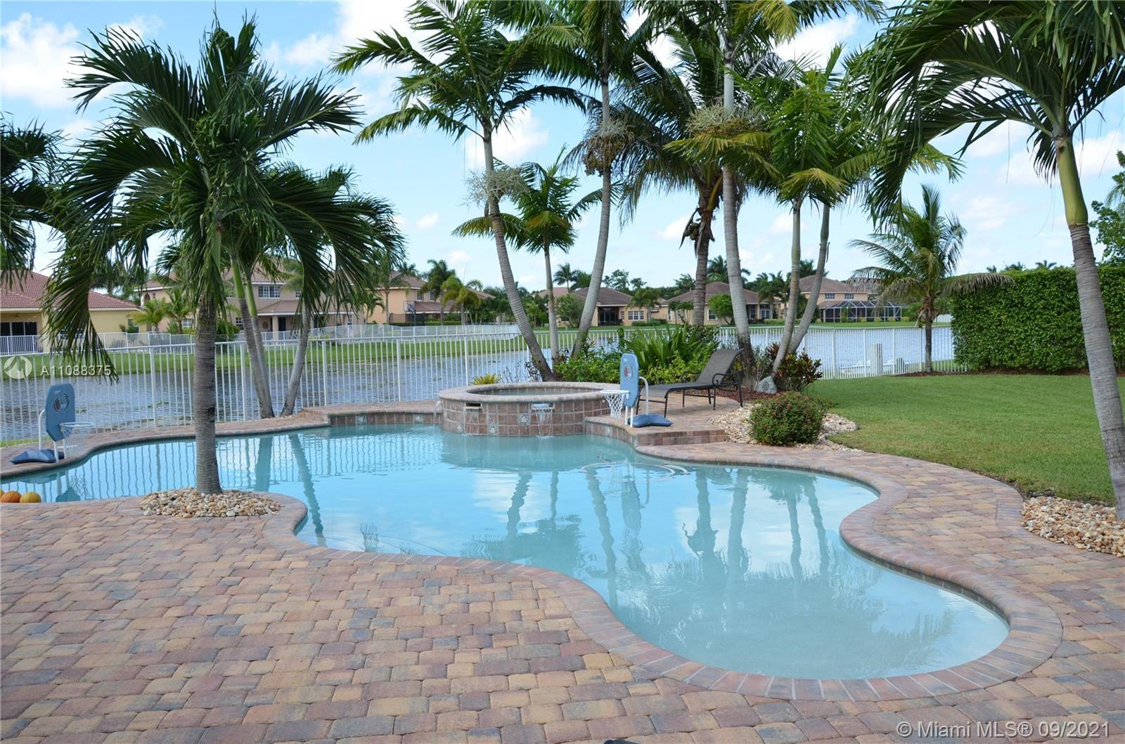 Photo of 1225 CHENILLE CR, Weston, FL 33327 (MLS # A11088375)