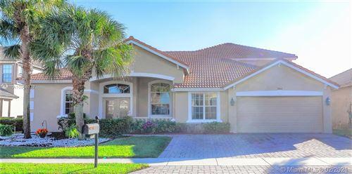 Photo of 3864 Hamilton Ky, West Palm Beach, FL 33411 (MLS # A10966377)
