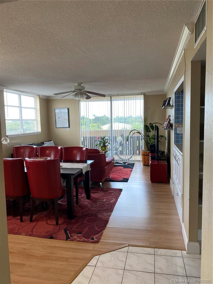 Photo of 406 NW 68th Ave #522, Plantation, FL 33317 (MLS # A10868377)