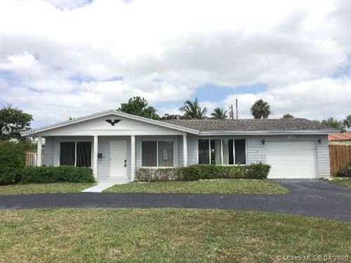 Photo of 4401 NW 8th St, Coconut Creek, FL 33066 (MLS # A10679381)