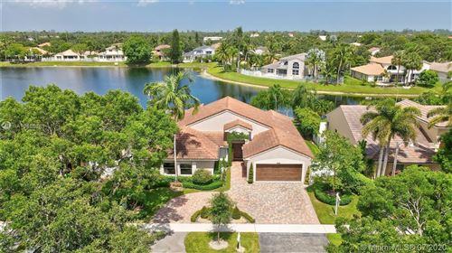 Photo of 912 NW 132nd Ave, Sunrise, FL 33325 (MLS # A10886381)