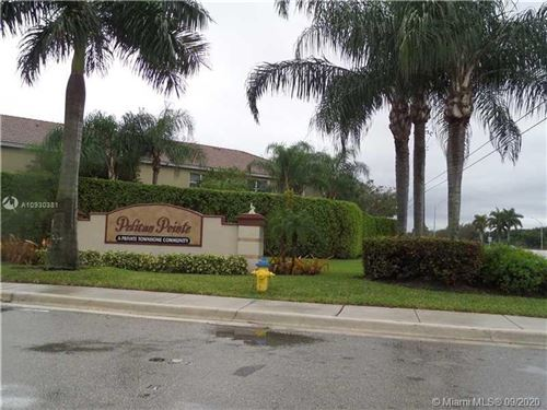 Photo of 12117 SW 2nd St #1211, Pembroke Pines, FL 33025 (MLS # A10930381)