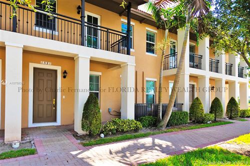 Photo of 1521 SW 147th Ave #1521, Pembroke Pines, FL 33027 (MLS # A10758383)
