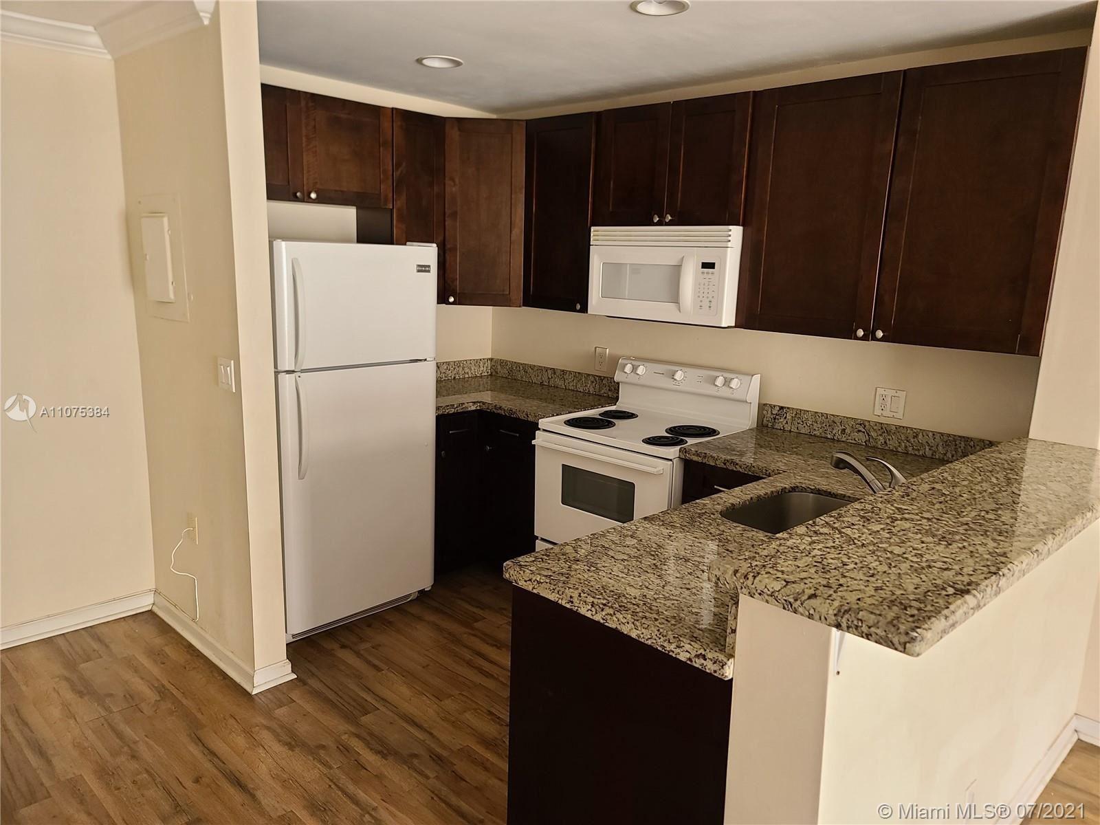 Photo of 10884 Royal Palm Blvd #10884, Coral Springs, FL 33065 (MLS # A11075384)