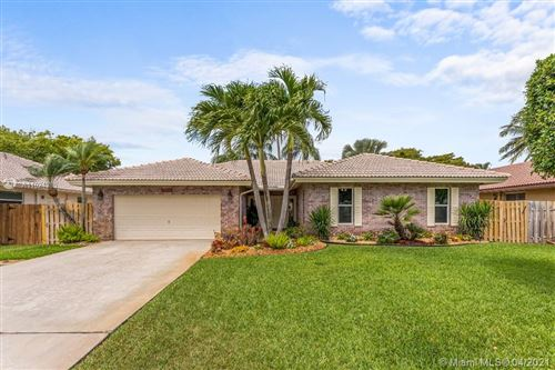 Photo of 4310 NW 70th Ln, Coral Springs, FL 33065 (MLS # A11024385)