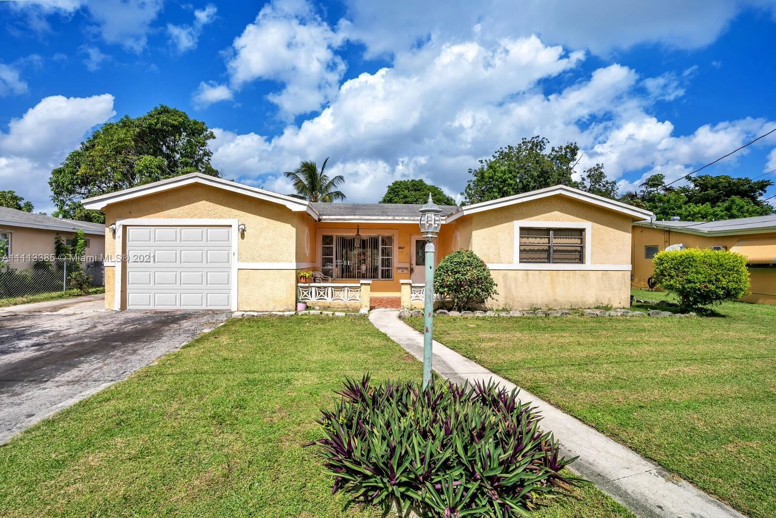 Photo of 3457 NW 32nd St, Lauderdale Lakes, FL 33309 (MLS # A11113385)
