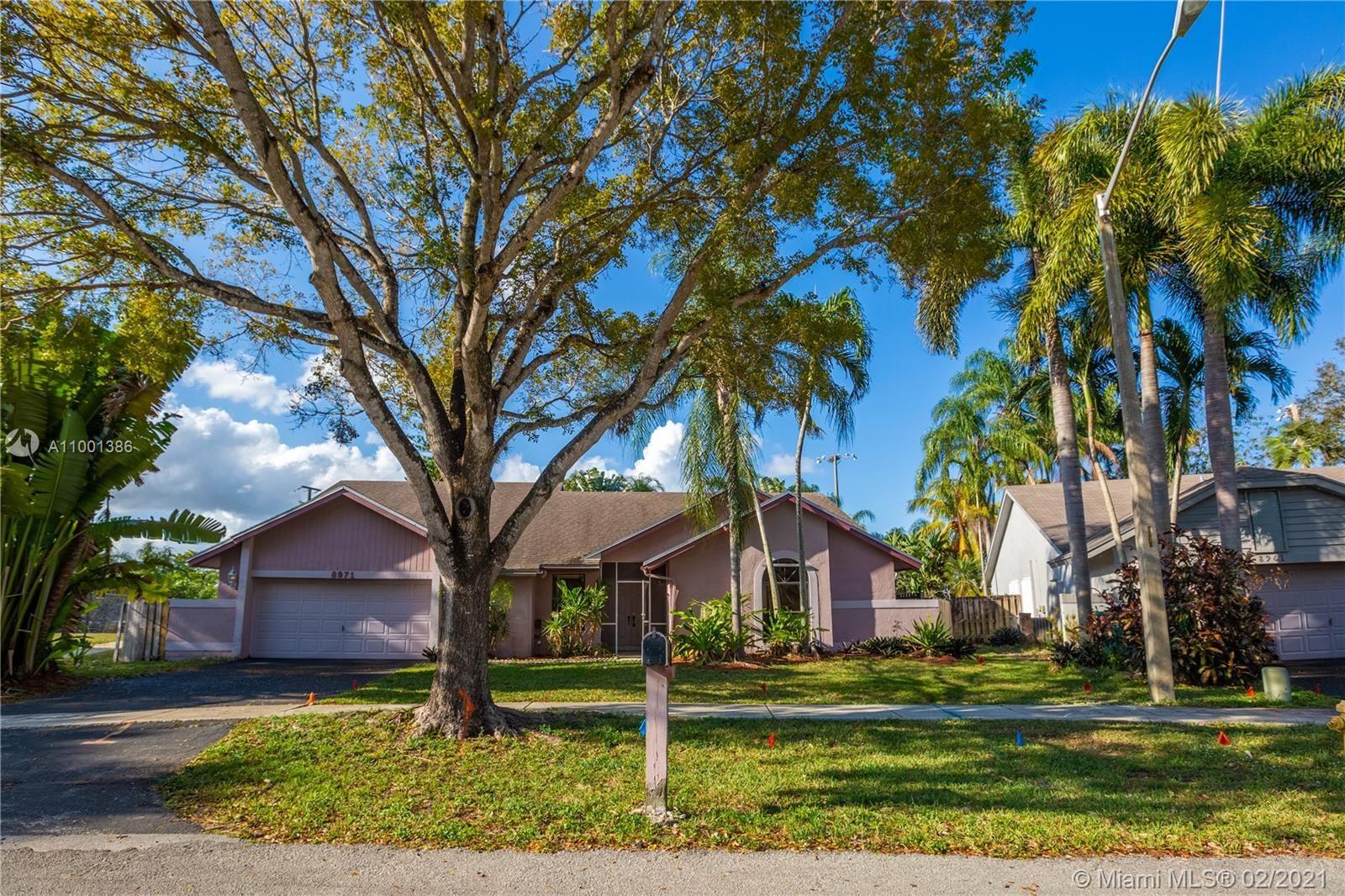 Photo of 8971 SW 57th St, Cooper City, FL 33328 (MLS # A11001386)