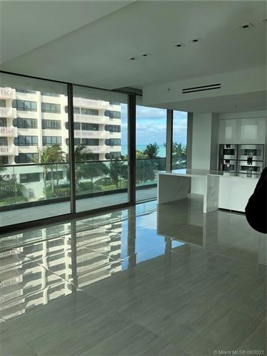 Photo of 10203 Collins Ave #411, Bal Harbour, FL 33154 (MLS # A10942388)