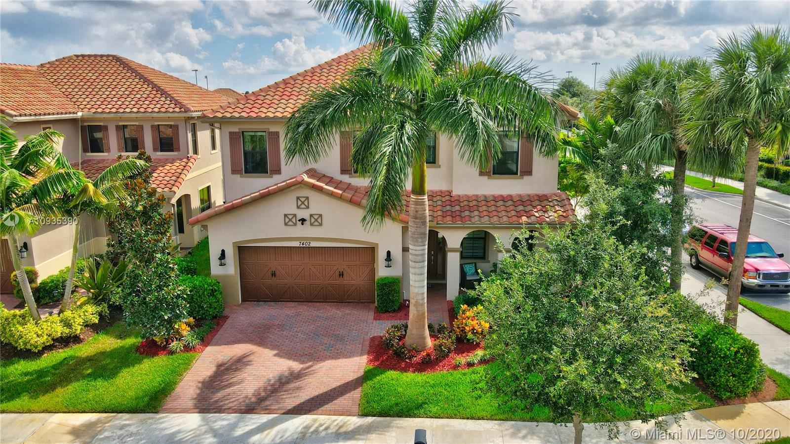 Photo of 7402 NW 109th Way, Parkland, FL 33076 (MLS # A10935390)