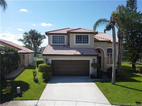 Photo of 551 SW 181st Ave, Pembroke Pines, FL 33029 (MLS # A11088393)